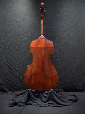 She chose some very colorful flamed Big Leaf Maple for the back and sides.
