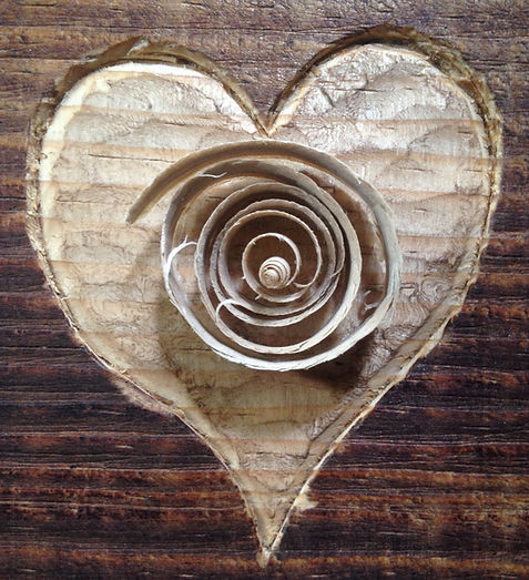 image of Carved heart and wood chip spiral ©2019 by Seth Kimmel  Bass maker of American Made Double bass violins