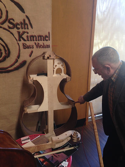 image of Chuck Isreals checking out his new bass in progress 2016 by Seth Kimmel  Bass maker/luthier of American made, real wood, hand-carved, double bass violins; Eugene, Oregon, USA
