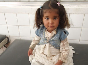 Renad, age 4, before she receives her pr