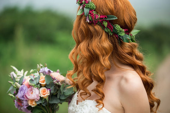 Bride in the park. Red-haired woman. The