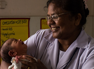 Indian Nurse and Baby.png