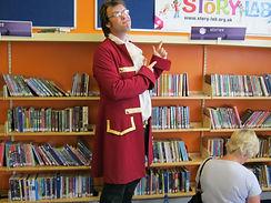 Ben storyteller with books.jpg