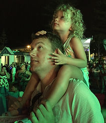 Dad and daughter watching fireworks