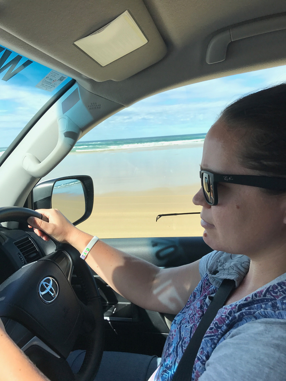 Bec taking the wheel on 75 Mile Beach