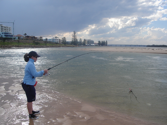 Bec reeling in a bream