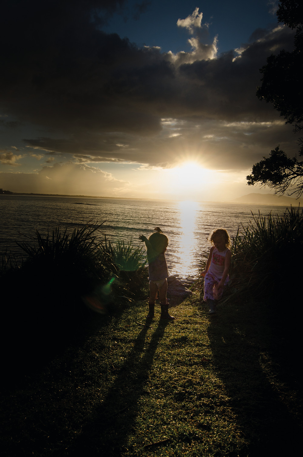 Ava and Finn soaking up the sunset. Trial Bay, South West Rocks