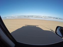 Late afternoon beach driving