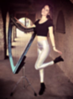 Katie Pachnos with her electric harp