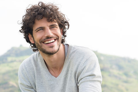 Portrait Of Young Handsome Man Smiling O