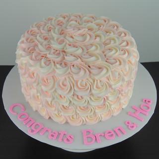 Elegant Light Pink and White Rosette Cak