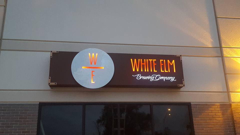 white_elm_store_sign_metal