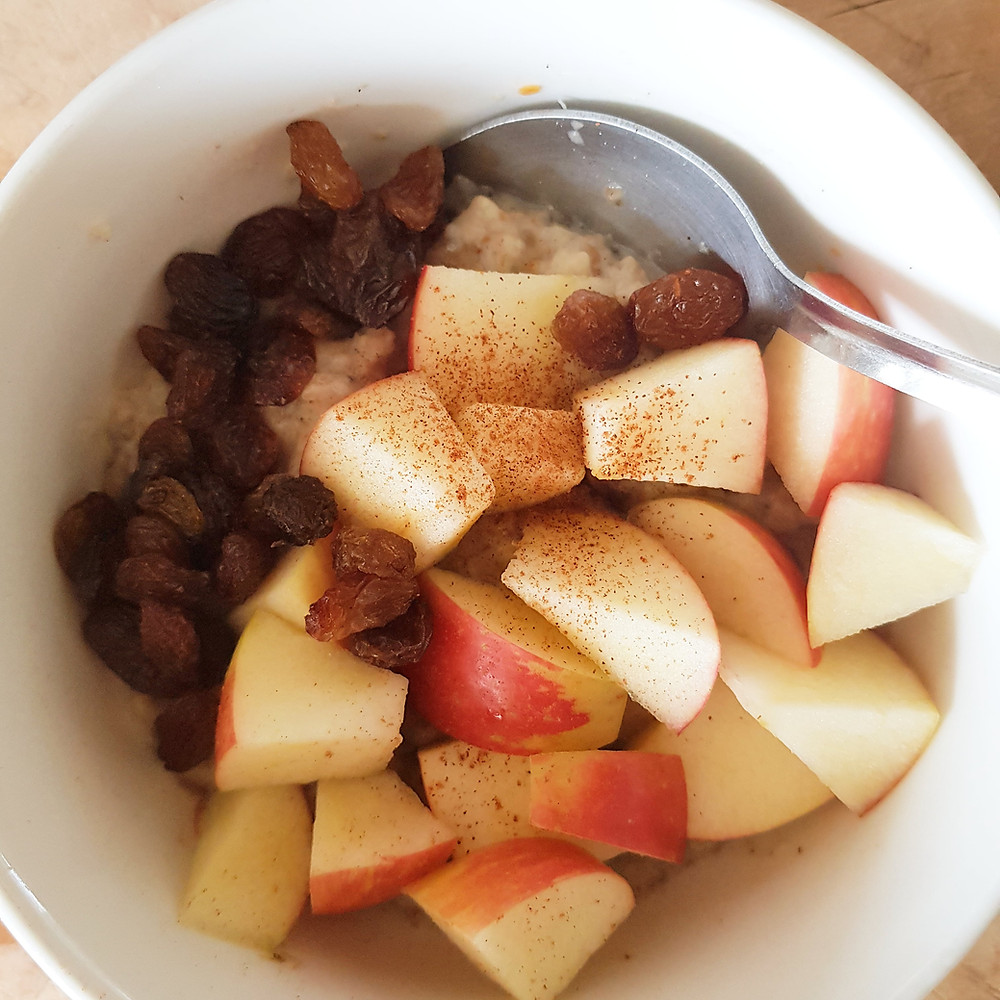 Porridge topped with apple and sultana