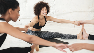 group of women stretching together
