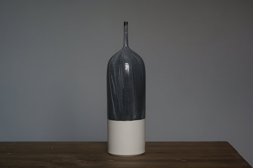 Porcelain bottle vase in granite flow glaze