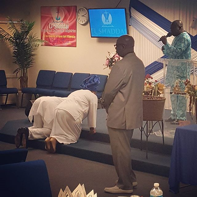 Pastor Isreal praying for Pastor and Pastor Mrs