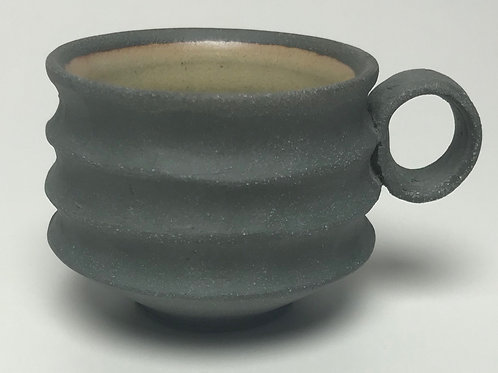 Thrown and carved cup with yellow interior