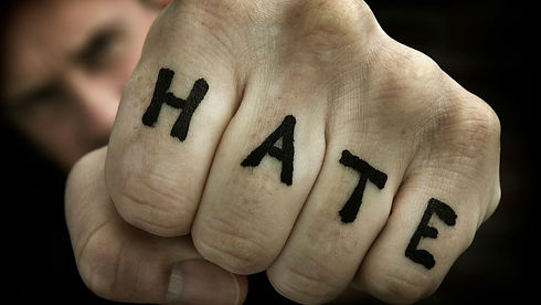 Fist with HATE written on the fingers.