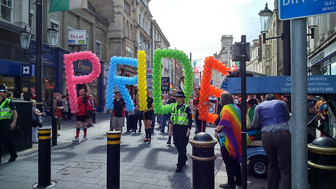 Pride written with baloons.