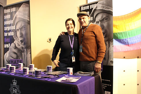 Robin and Steph on the Hate Crime stand at Can I Come Out Now?.png