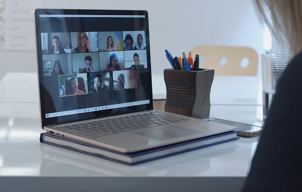 A laptop with a video conference on the screen