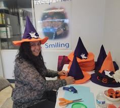 West Coast University Nursing Student decorating some Witchy hats