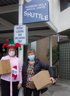 Sheri dropping off Christmas Happy Hats to Shari at Harbor-UCLA Medical Center