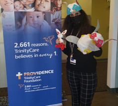 Stephanie, Director of Special Events at Trinity KidsCare Hospice receiving Easter Happy Hats for the children