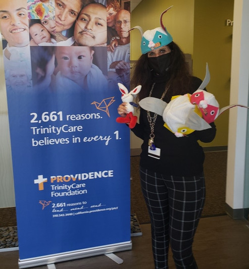 Stephanie, Director of Special Events at Trinity KidsCare Hospice recieveing Easter Happy Hats for the children