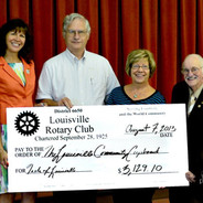 Louisville Rotary Presents Check to Comm