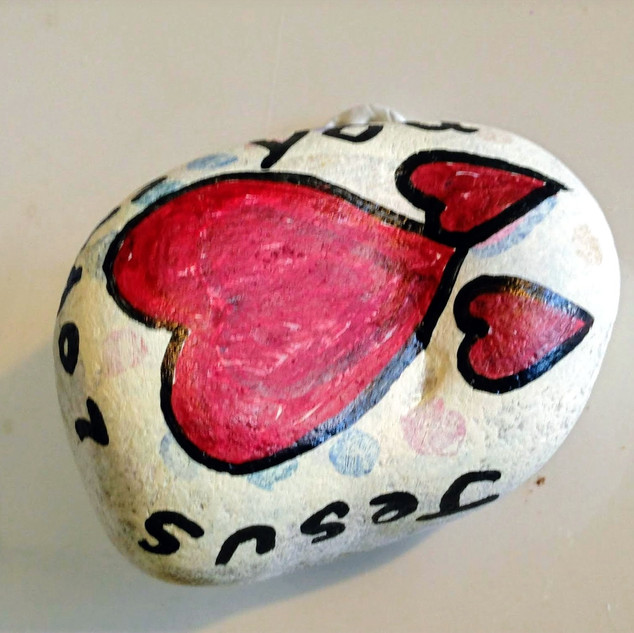 What a great idea! A pebble with a beautiful design and message.