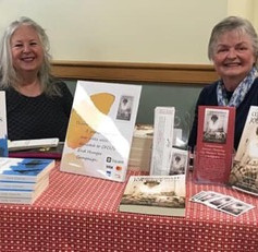 Jane and Cheryl selling books