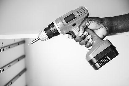 man-using-an-electronic-drill.jpg