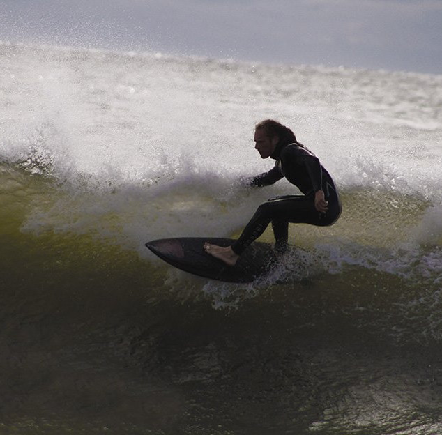 Surfing top of a wave.jpg