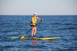 Woman paddler in yellow