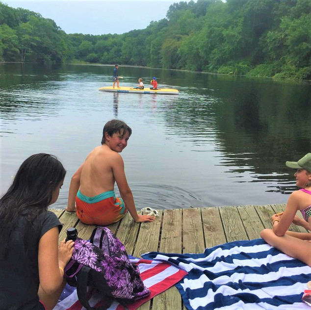 Sitting on the dock with paddleboard.jpg