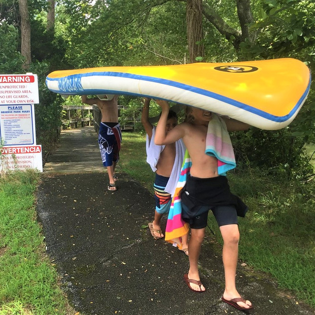 Carrying the big paddleboard.jpg