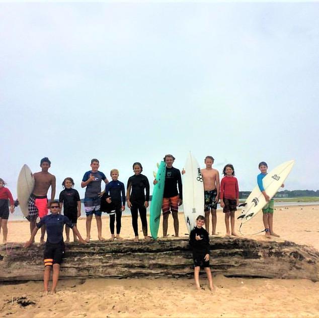 Group photo on beach log.jpg
