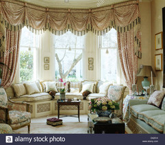 swaggedtailed-silk-curtains-on-bay-windo