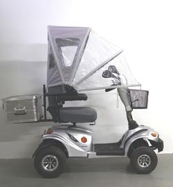 Regenschutz auf Elektromobil
