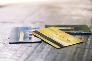 several-credit-cards-wooden-table.png