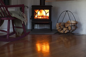 Flames in small wood burning stove refle