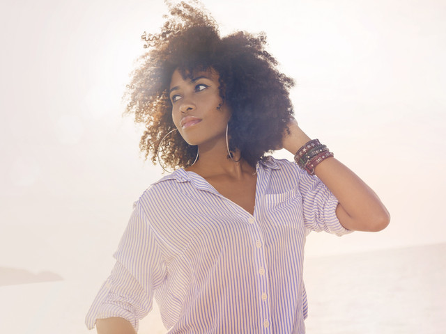 african american young woman on beach at