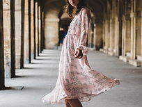 lady in a flowing pink florel dress