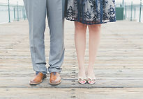 Mens gray pants and ladies knee length blue dress