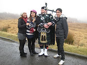 Students with Scottish piper