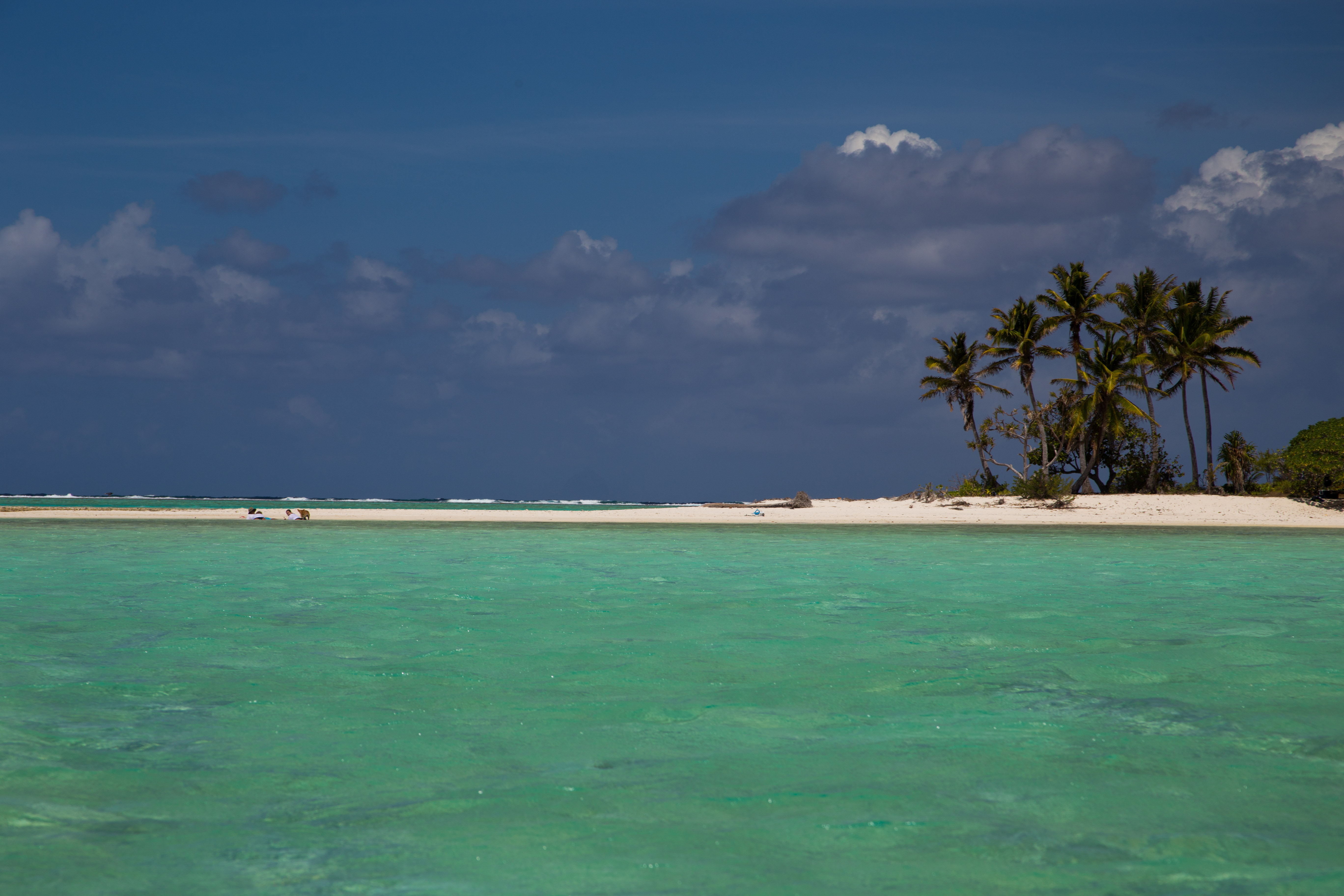 lazing on a motu in Maupiti's lagoon