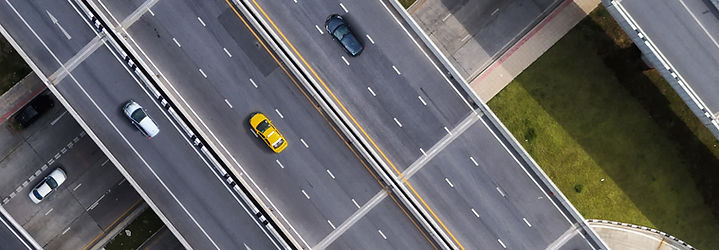 Aerial view of highway with cars on it