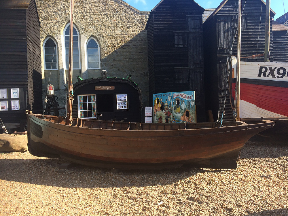 Photograph of a two-masted Hastings beach lugger on display outside the Hastings Fishermen's Museum, Old Town, Hastings