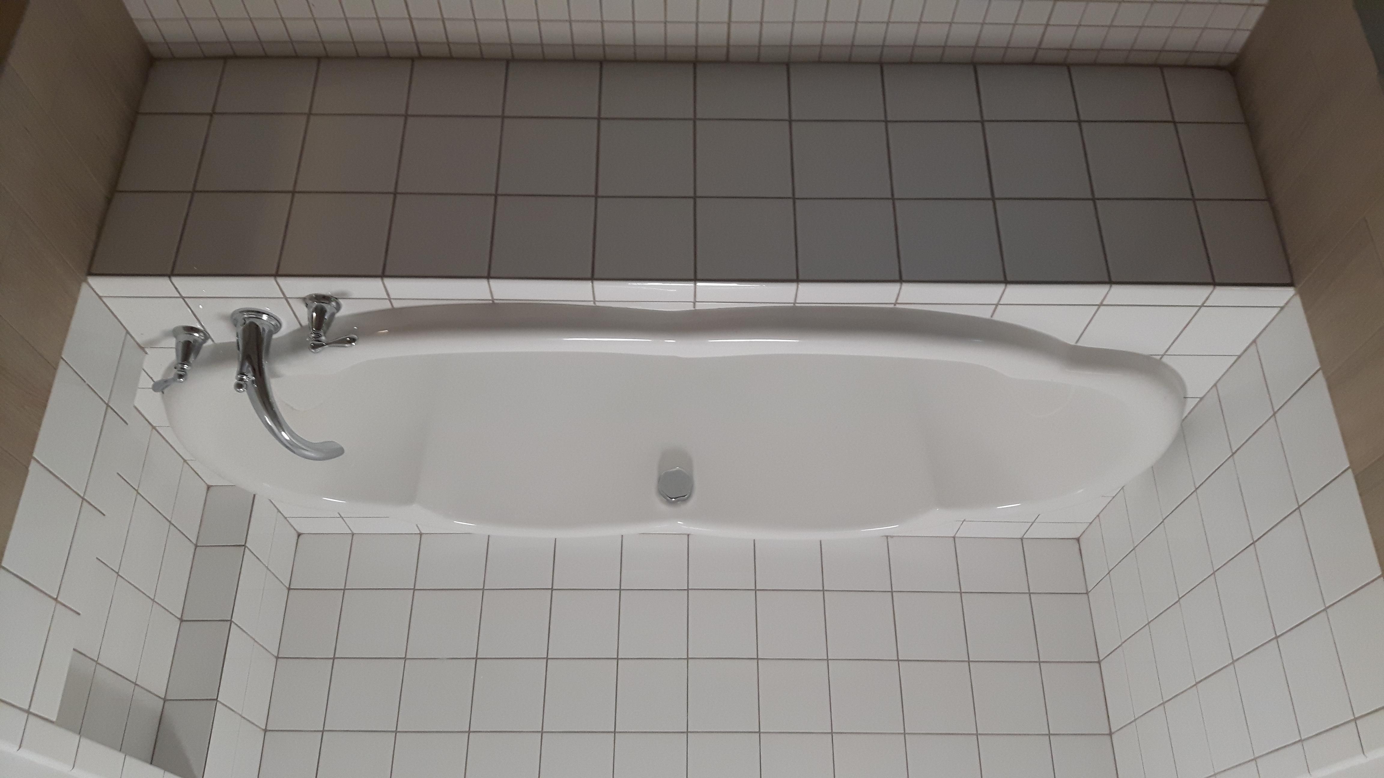 soaker tub white tile surround